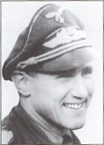 A young pilot with III/JG52 at the outbreak of war.  He quickly demonstrated his natural ability and leadership qualities, scoring his first air victory early in the Battle of Britain, and by July 1940 was leading 8/JG52.  After transfer to the Eastern Front his air victories mounted at an astonishing rate.  A crash hospitalised him but within nine months he was back in the cockpit, and, when commanding III/JG52, gained the Wings 500th victory.  Gunther fought throughout the war to become the 3rd highest Ace in history with 275 victories.  He was awarded the Knights Cross with Oak Leaves and Swords.  Gunther Rall was born on March 10, 1918 in the small Bavarian town of Gaggenau, Baden. Immersing himself in Boy Scout activities during the difficult economic times in Germany following WW 1, Rall finished school in 1936 and joined the German Army. Influenced by a friend, who was a young officer in the Luftwaffe, Rall entered pilots school in 1938. His initial posting was with JG52. He attained his first aerial victory during the Battle of France in May of 1940. During the Battle of Britain JG52 absorbed many casualties, and Rall was promoted to Squadron Commander at the young age of 22. With his fair-hair and smooth complexion the young officer looked even younger than his years. But behind this pleasant exterior was a fierce competitor with the heart of a tiger. Later, Ralls squadron would support the attack on Crete, followed by deployment to the Southern Sector on the Eastern Front. Ralls victory totals began to mount. Following his 37 th victory, GiInther was himself shot down. He was lucky to survive the crash, but with a badly broken back he would spend most of the next year in various hospitals. In Vienna at the University Hospital he would meet his future wife, Hertha. Miraculously, Rall recovered and returned to the Luftwaffe in August of 1942. By November his score exceeded 100 and he was awarded the Oak Leaves to accompany the Knights Cross he was awarded only weeks earlier. As the War progressed against Russia, Rall began to encounter ever more experienced Soviet pilots flying better performing aircraft. Despite this fact, and being shot down several more times himself, Ralls victory tally kept rising. By March of 1944 the ace had attained 273 aerial victories. With the War now going badly for Germany, Rall was transferred to the Western Front. He was able to attain only two more victories against the swarms of Allied bombers and fighter escorts which now pounded Germany every day and night. In May of 1944 Rall was shot down by a P-47. Losing his thumb in the battle he remained out of combat until later in 1944. Ralls final assignments included flying 190Ds as Kornmodore of JG300, and flying the Me-262 jet. Ralls 275 aerial victories (attained on less than 700 combat sorties) make him the third highest scoring ace of all time. If not for the down time suffered as a result of his broken back, Rall might have actually equaled or exceeded Erich Hartmanns alltime record of 352 aerial victories. Rall was not much for socializing during the War. He was a fierce competitor with a businessmans attitude about flying. He was an excellent marksman, and possibly the best deflection shot expert of the War. He continued to fly with the Bundeslufwaffe following the War, serving as its Commander-In Chief in 1970-74.  Sadly Gunther Rall died on 4th October 2009.