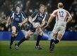 Scotland beat England 18-12 to win the Calcutta Cup at Murrayfield.  Chris Paterson won the day converting 5 penalties to Charlie Hodgson's 4 with Dan Parks adding a drop goal.  The painting shows Jason White supported by Nathan Hines about to c......