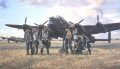 Depicting the morning after a gruelling operation during the autumn of 1944. As day breaks a returning crew awaits the crew bus at their aircraft dispersal, grouped before their mighty bomber which shows fresh scars of battle from an arduous mission over occupied Europe. The exhausted men are clearly relieved and thankful to be safely home at their in Lincolnshire base.