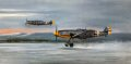 The roar of Daimler-Benz engines at full power awakens the day as Gunther Lutzow, his aircraft still in the markings of his previous unit JG51, leads his Me109Fs of JG3 into combat from a snow covered airfield at Schatalowka on the Russian Front, in December 1941. With prints signed by no less than four veteran Me109 pilots who fought on the cruel Eastern Front, this is sure to be a valuable addition to any aviation art collection.