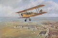 A de Havilland DH.82A Tiger Moth over Hatfield Aerodrome, early in 1939.  Hatfield was the home of the de Havilland Aircraft Company and No.1 Elementary Flying Training School. ......