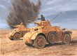 North Africa, 18th November 1941.  Italian Autoblinda armoured cars of Gen. Gambara's XX Mobile Corps trade shots with forward reconnaissance elements of the British 22nd Armoured Brigade, during the initial hours of Operation Crusader.  Their q......