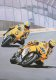 Valentino Rossi leads team mate Colin Edwards on the 50th Anniversary Yamahas at the US Moto GP at Laguna Seca, California in 2006.