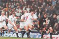 England 31 - New Zealand 28. Played at Twickenham, November 9th 2002. England : Robinson, Simpson Daniel, Greenwood, Tindall, Cohen, Wilkinson, Dawson, Woodman, Vickery, Thompson, Grewcock, Johnson, Moody, Hill, Dallaglio. (Subs) Back, Healey, B. Johnson, Kay, Leonard, Regan, Stimpson. Scores: Try - Moody, Try - Wilkinson, Try - Cohen, Drop Goal - Wilkinson, 2 Conversions - Wilkinson, 3 Penalties - Wilkinson. <br><br>New Zeland: Blair, Howlett, Lowen, Umaga, Lomu, Spencer, Devine, McDonnell, Meeuws, Hore, Williams, Robinson, Randell, Holah, Broomhall, (Subs) Hayman, Lee, Mealamu, Mehrtens, Mika, Robinsom, So oialo. Scores: 2 Tries - Lomu, Try - Howlett, Try - Lee, 2 Conversions - Blair, 2 Conversions - Mehrtens.