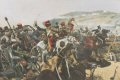 Depicting the Light Brigade at the moment of reaching the Russian guns. Shown are the 11th Hussars and the 17th Lancers.  The all time classic image of the disastrous  Charge of the Light Brigade which included the 17th lancers, who lead the charge.  Lord Cardigan is shown on the left, dressed in his 11th Hussars uniform.   The Light Brigade were being kept in reserve, after the successful charge of the heavy brigade, but the slow advance of the British Infantry to take advantage of the heavy brigades success had given the Russian forces time to take away Artillery pieces from captured redoubts.  Raglan, after seeing this ordered the light brigade to advance rapidly to the front, follow the enemy and try to prevent the enemy carrying away the guns. This message taken by Captain Nolan, to Lord Lucan, the cavalry Commander.  One of the Officers of Raglans Staff, urged Lucan, who could only see the main Russian Artillery position at the head of a valley.  Lord Lucan rode over to Cardigan and ordered him to attack these guns.  So the Light Brigade charged these Russian guns, and not the guns being taken away by Russian forces from the redoubts. The carnage was great, from the 673 men who started the charge, 113 men were killed and many others wounded. The Light Brigade was made up of the 4th and 13th Light Dragoons, 8th and 11th Hussars and the 17th Lancers. A spectating French Officer General Pierre Bosquet proclaimed - It is magnificent but it is not war.